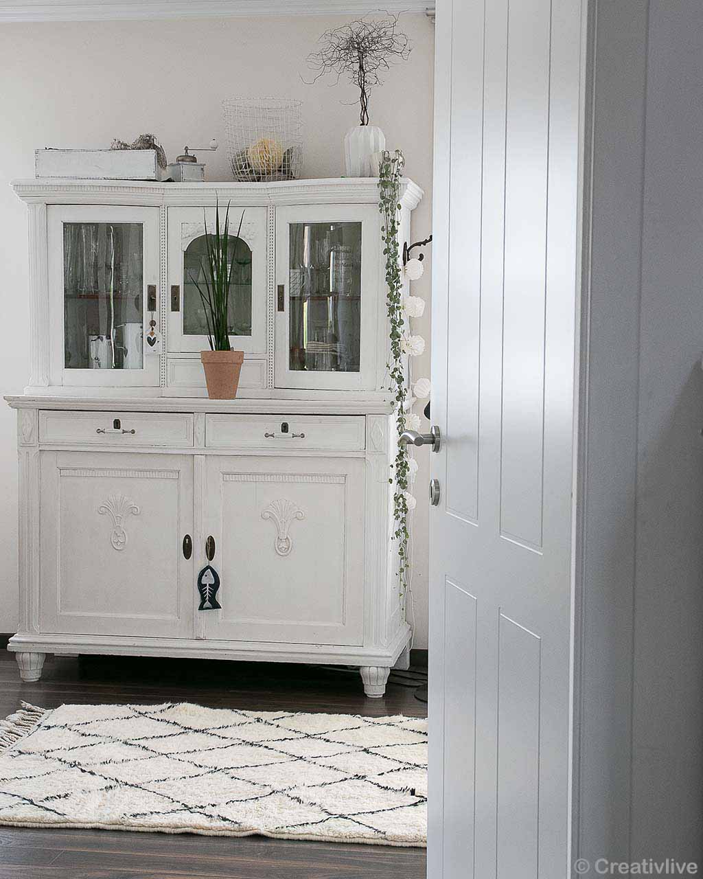 beautiful white cabinet made by moroccan kids rugs