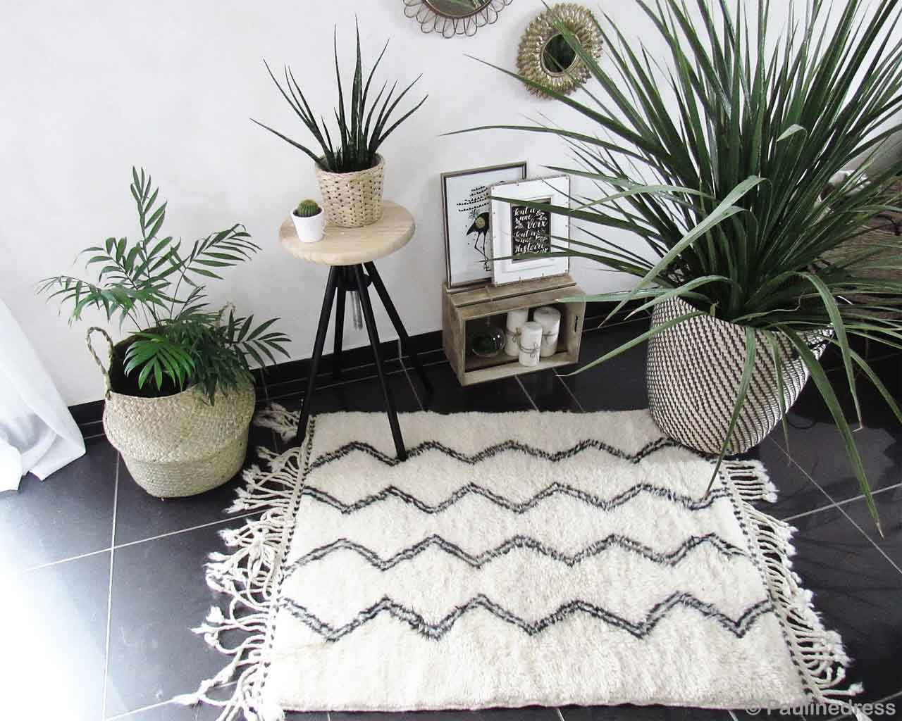 hand knotted wall hanging mirror and pots with green plants danish design capel rugs