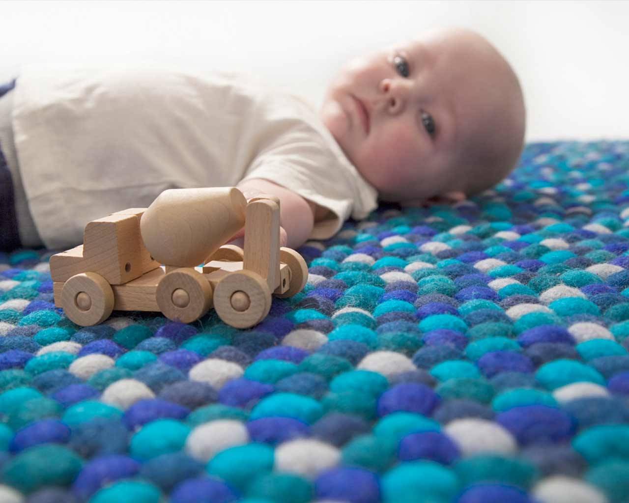 felt ball rug design round baby play wooden car