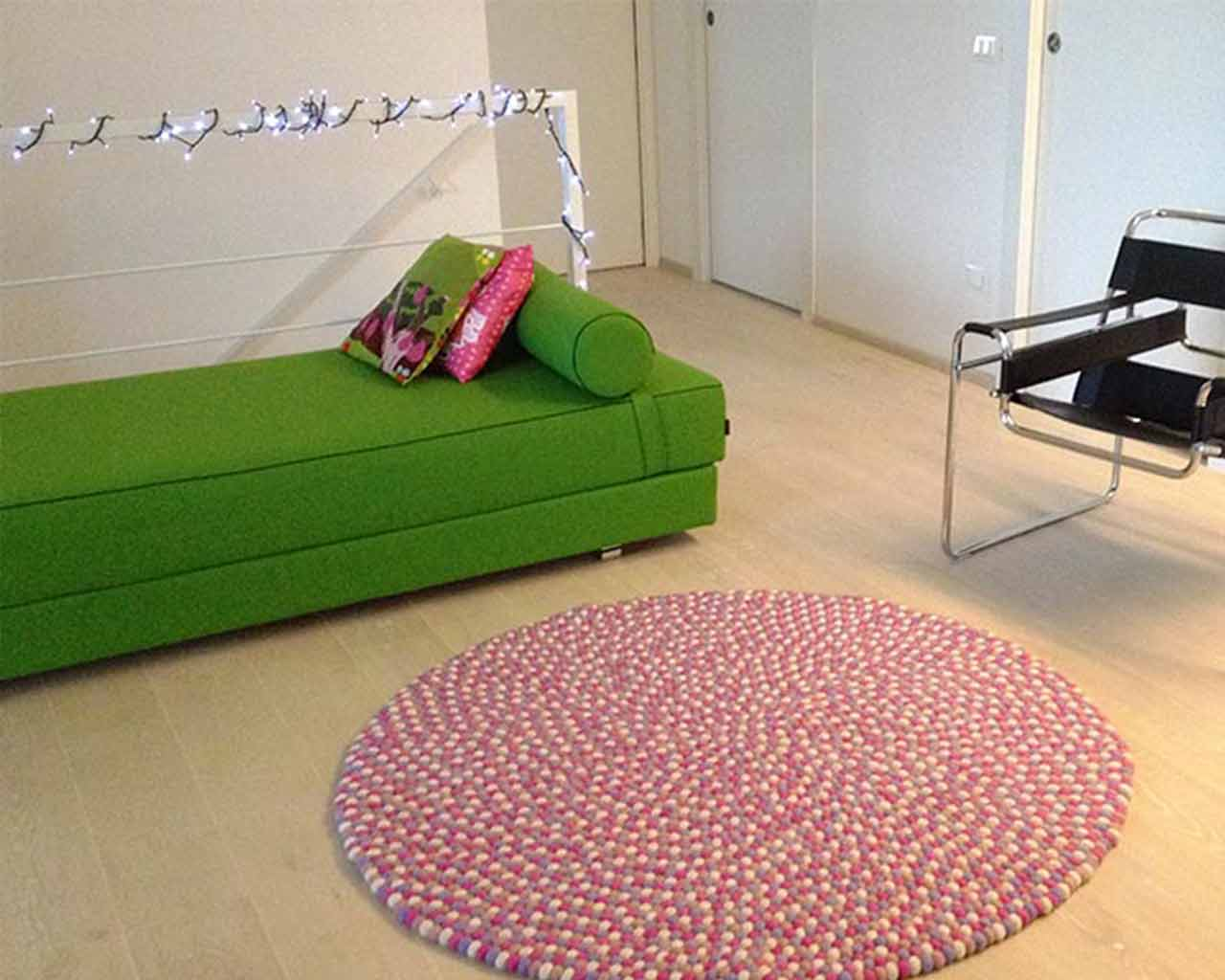 leather chair green couch pink rug felt